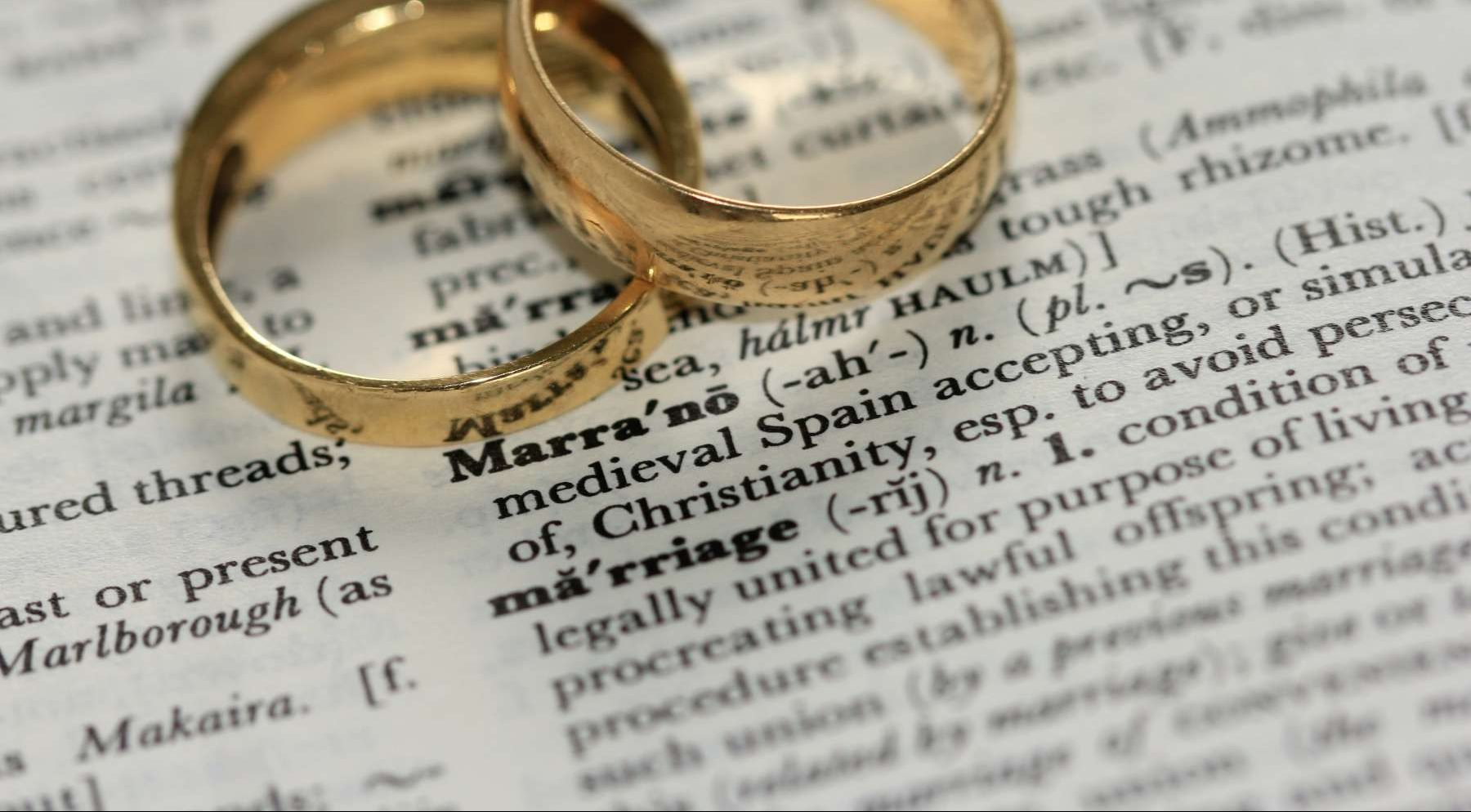 Two Gold Wedding Rings on a dictionary definition of marriage